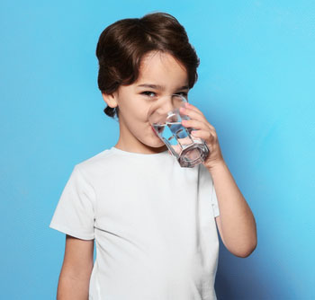boy-drinking-water-from-glass
