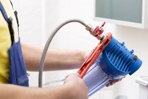 plumber-installing-new-water-filter