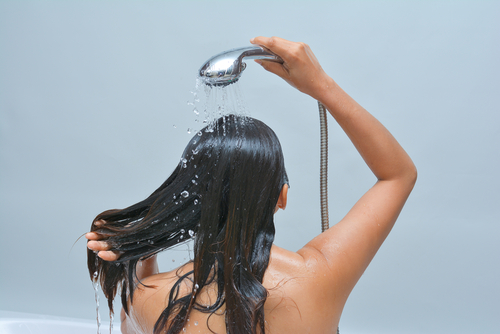 woman-washing-her-hair-with-shower-water
