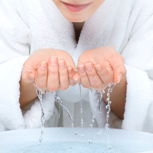 young-woman-washing-face-with-clean-water